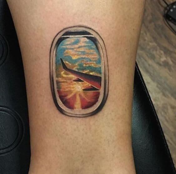 Man wearing a single needle tattoo on his arm