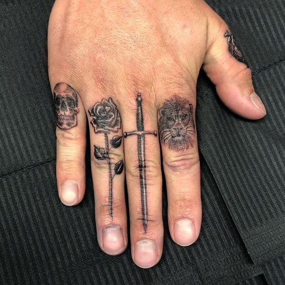 Man wearing multiple single needle tattoos on his fingers