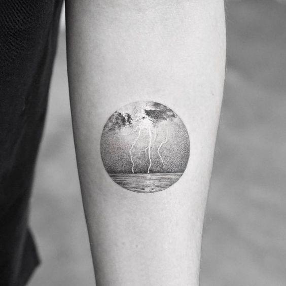 Man wearing a single needle tattoo on his forearm