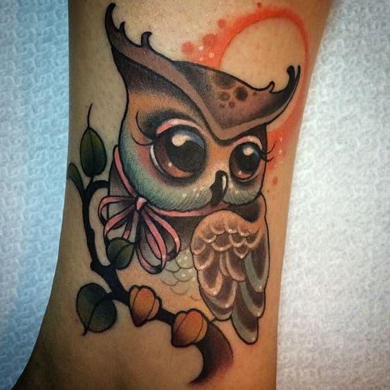 Woman wearing a New School owl tattoo on her leg