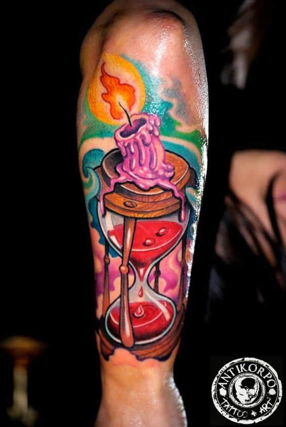 Woman wearing a New School tattoo on her forearm