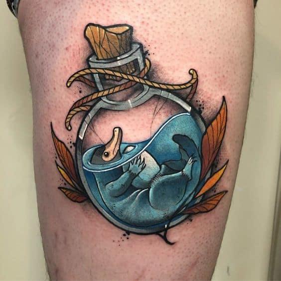 Woman wearing a New School tattoo on her leg