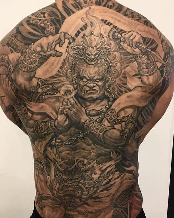 Black and grey Raijin tattoo on the back