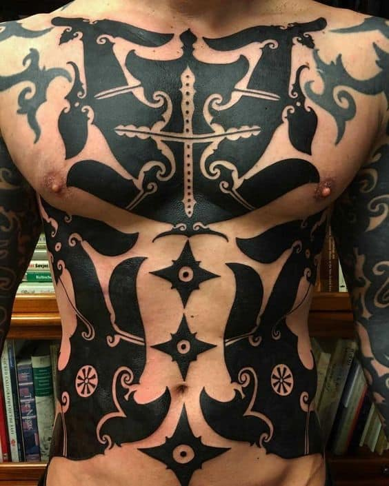 Dayak tattoo on the chest and on the abdomen