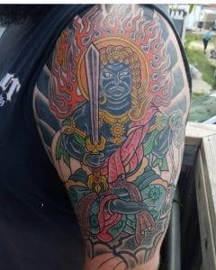 Fudo Myoo tattoo on the arm