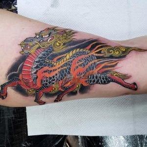 Kirin tattoo on the bicep