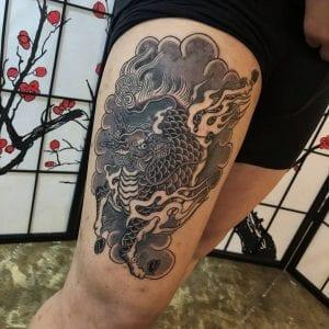 Kirin tattoo on the thigh