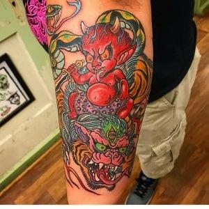Nue tattoo on forearm