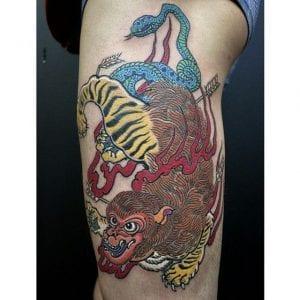 Nue tattoo on thigh