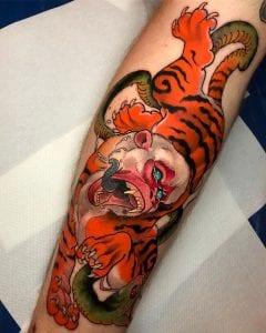 Nue tattoo on calf
