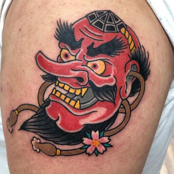 Tengu Mask tattoo on thigh