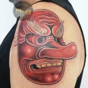 Tengu Mask tattoo on shoulder