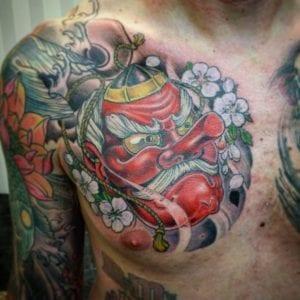 Tengu Mask tattoo on chest