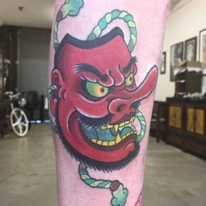 Tengu Mask tattoo on the leg
