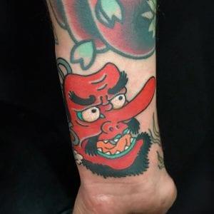 Tengu Mask tattoo on the wrist