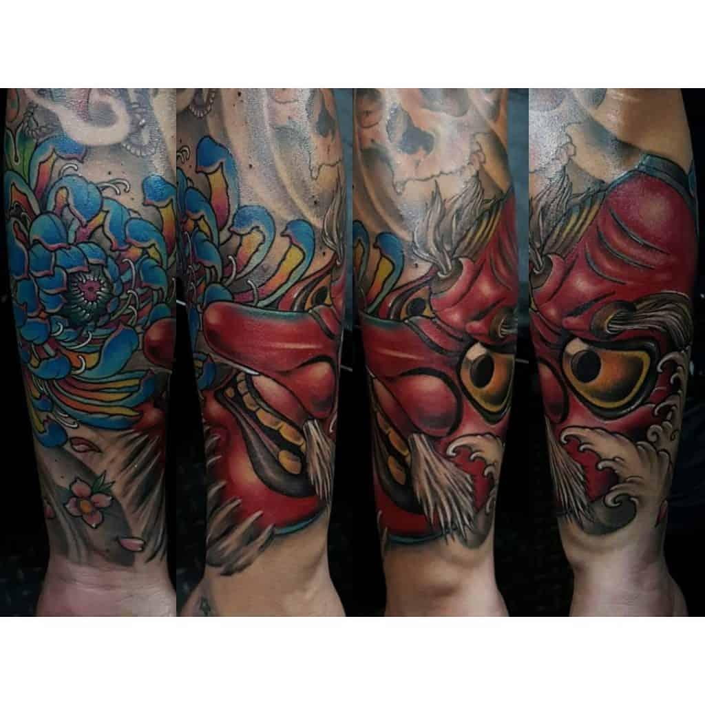Tengu Mask tattoo on the forearm