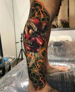 Tengu Mask tattoo on the calf