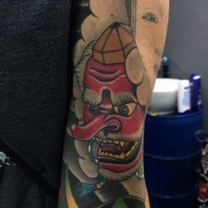 Tengu Mask tattoo on the arm