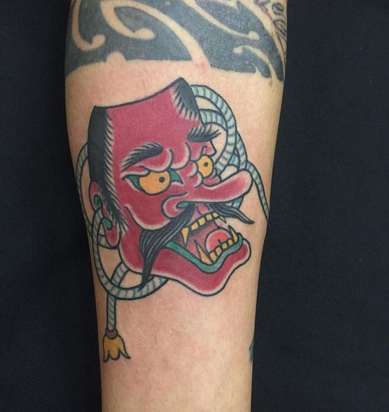 Tengu Mask tattoo on arm