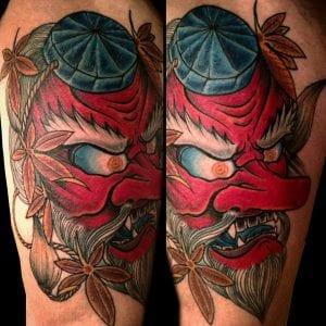 Tengu Mask tattoo on the thigh