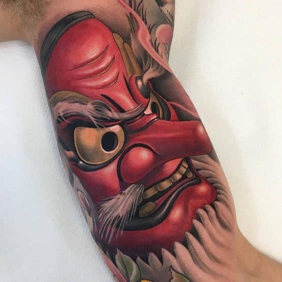Tengu Mask tattoo on biceps