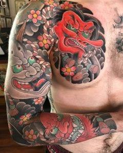Tengu Mask tattoo on the chest