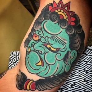 Fudo Myoo tattoo on the bicep