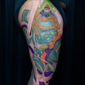Fudo Myoo tattoo on the thigh