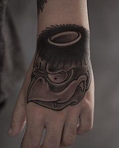 Black and grey Kappa tattoo