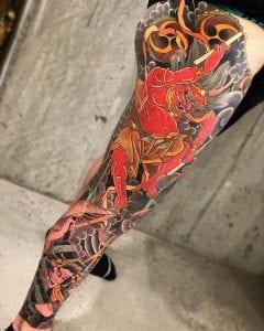 Raijin sleeve tattoo on the leg