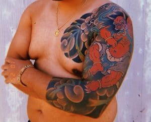 Raijin sleeve tattoo on the arm