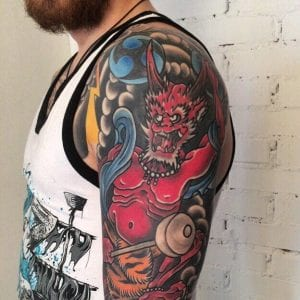 Raijin tattoo on the shoulder