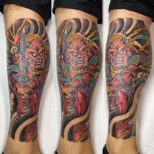Raijin tattoo on the calf