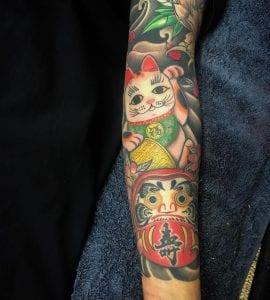 Maneki Neko sleeve tattoo