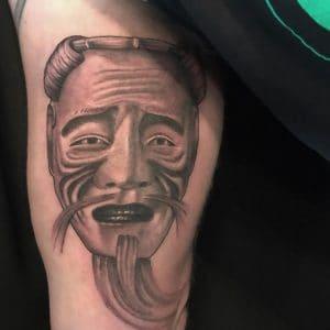 Okina mask tattoo