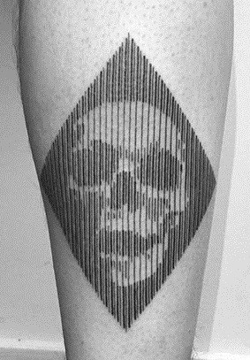 Negative Space Skull Tattoo