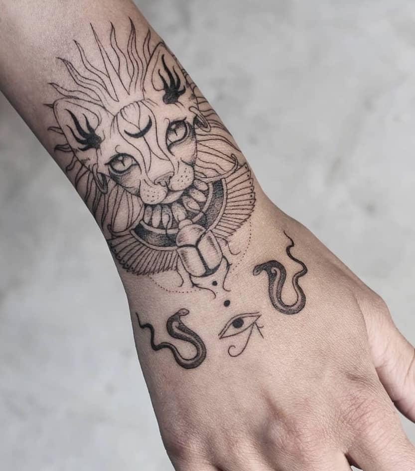 Eye of Horus and Bastet Tattoo