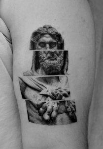Single Needle Greek Statue Tattoo