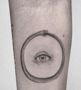 Single Needle Ouroboros Tattoo