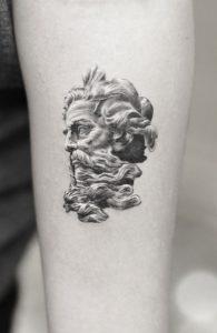 Single Needle Poseidon Tattoo