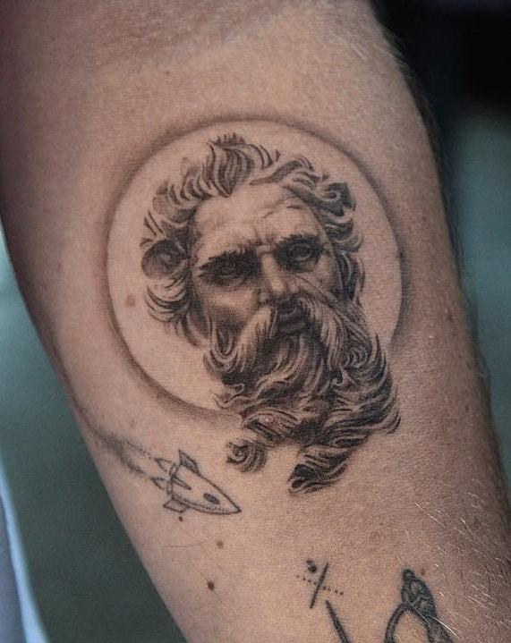 Small Poseidon Tattoo
