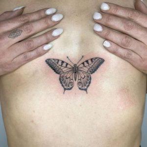 Sternum Butterfly Tattoo