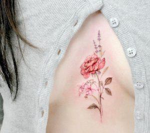 Sternum Rose Tattoo