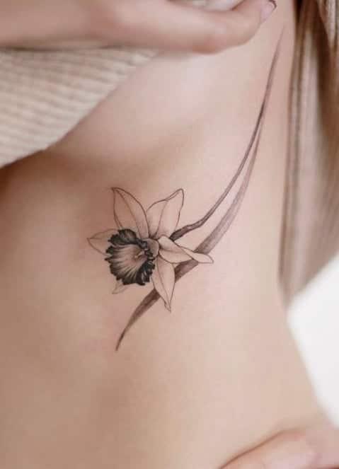 Under-boob Daffodil Tattoo