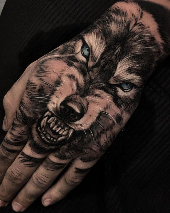 Wolf tattoo on the back of the hand