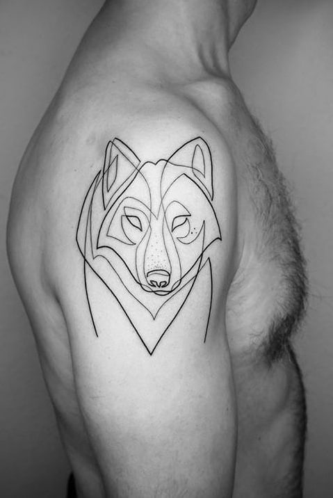 Wolf tattoo on the shoulder