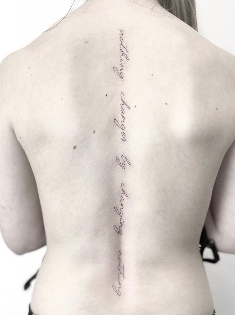 Lettering Tattoo on Spine
