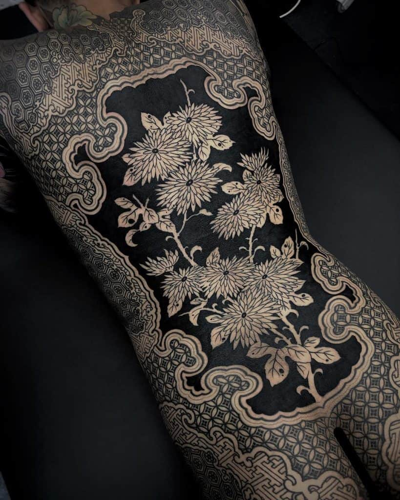 Negative Space Black-work Tattoo