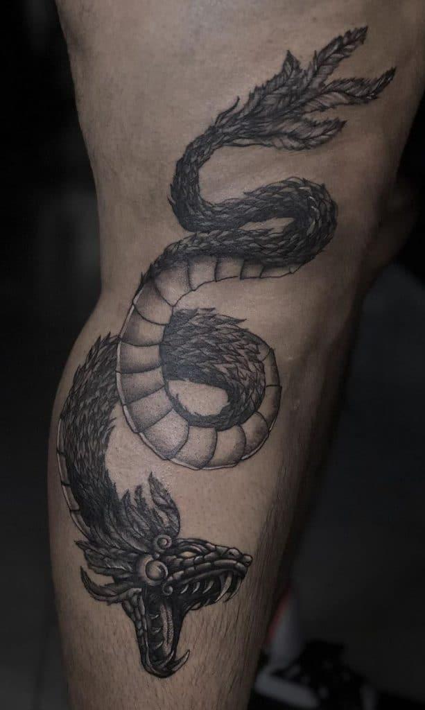 Black and Grey Quetzalcoatl Tattoo