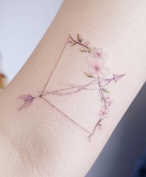 Delicate Bow and Arrow Tattoo